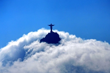 "Jesus in the sky - View from the sugar loaf to the Corcovado mountain with the ""Christ the Redeemer"" statue. Both two well known sights of Rio de Janeiro, Brazil."
